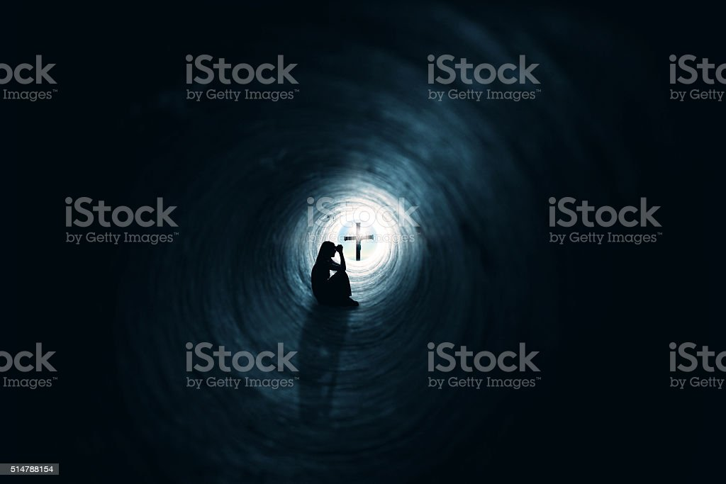 Woman Praying In Tunnel Christianity Faith Concept stock photo