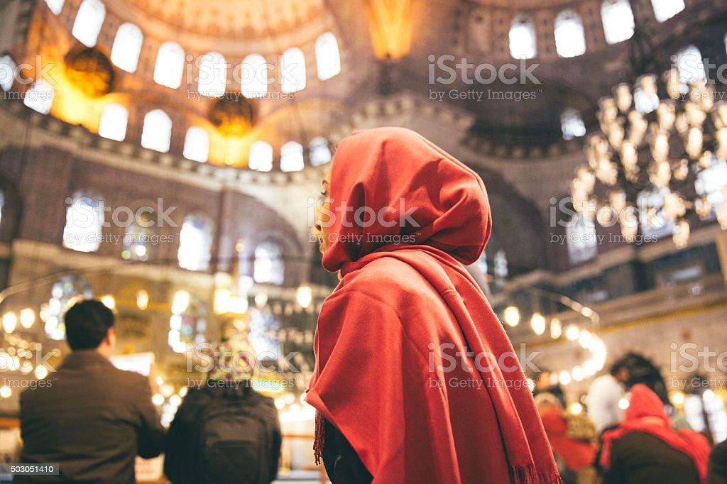 Woman Praying Inside A Mosque stock photo