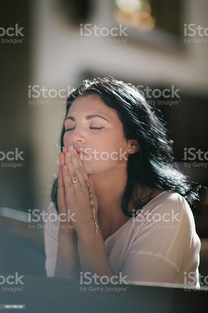 Woman praying stock photo