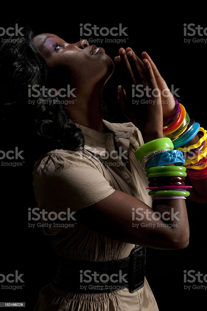 Woman praying profile royalty-free stock photo