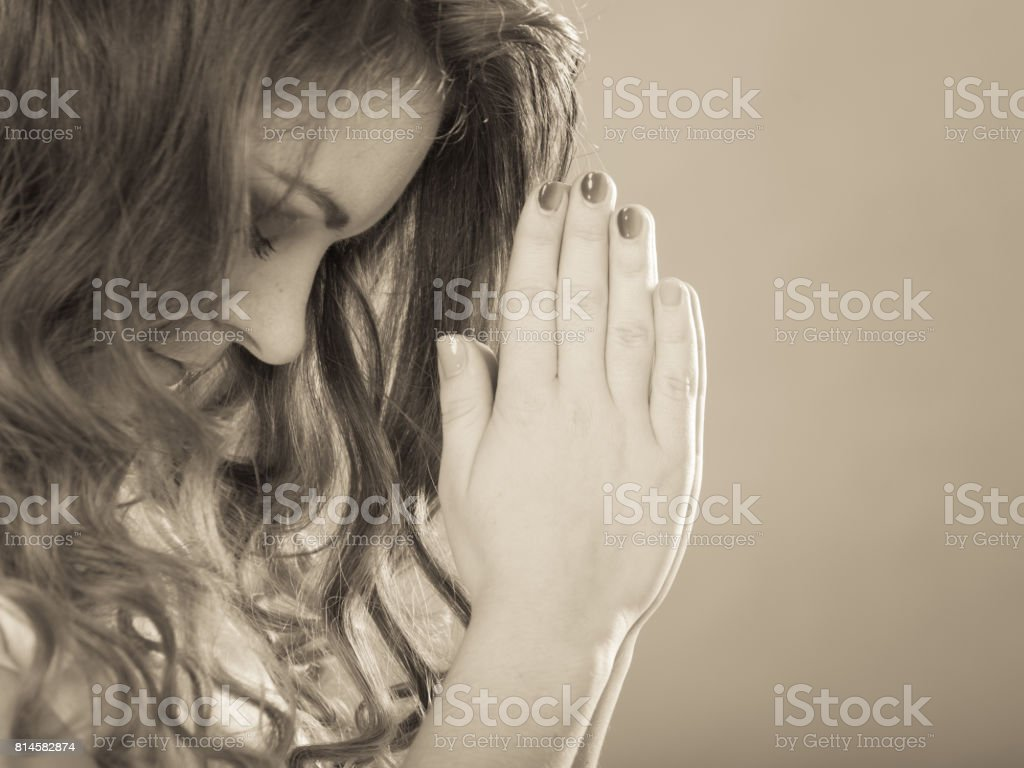 Religious woman praying to god jesus christ. Strong christian...