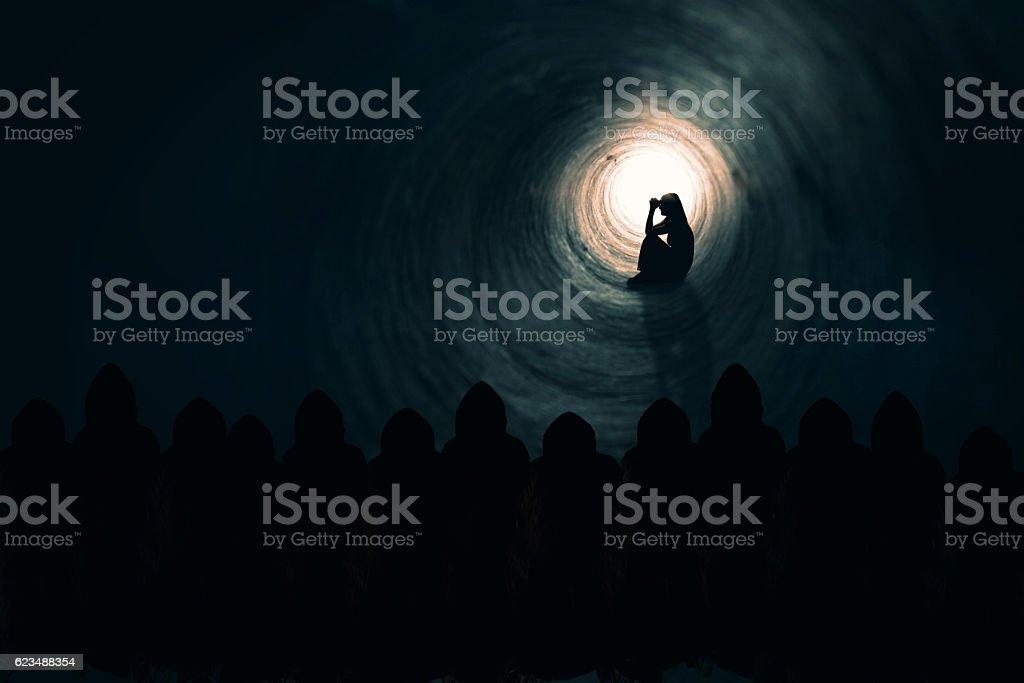 Woman Praying While Dark Souls Watch stock photo