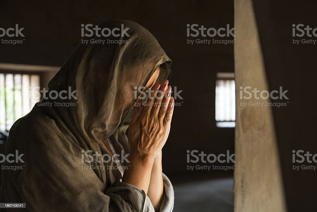 Woman praying with hands stock photo