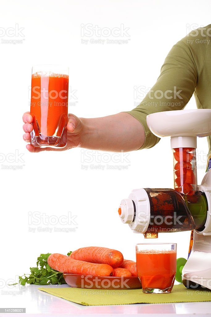 woman prepare Juice extractor and carrot stock photo