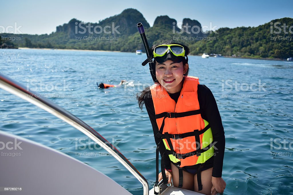 woman prepare snorkeling with life jacket stock photo