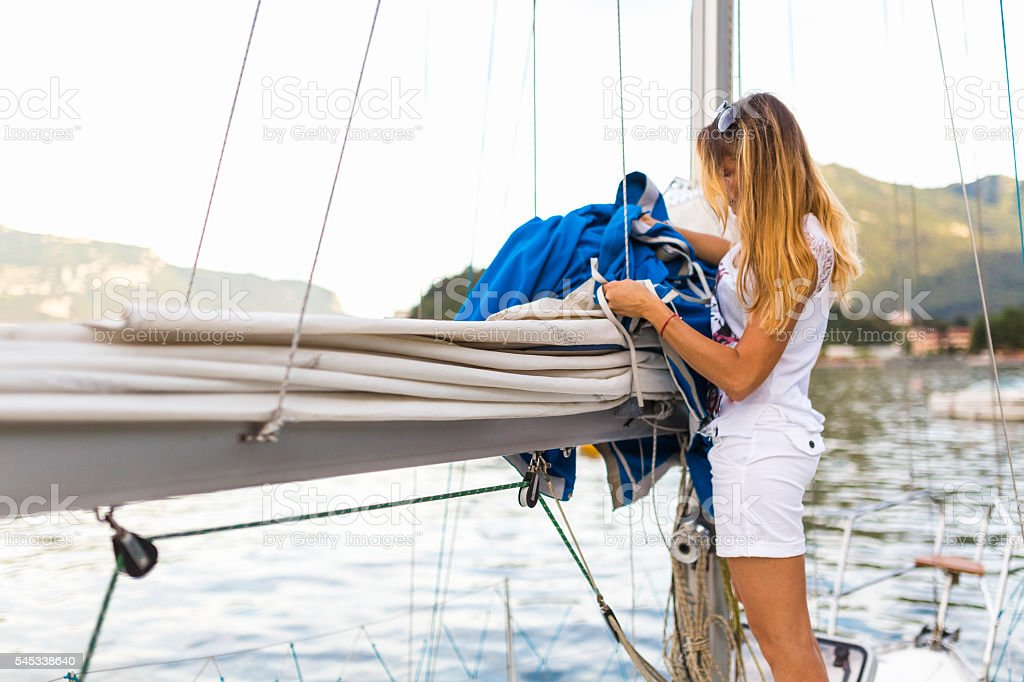 Woman prepare the sailboat navigation stock photo