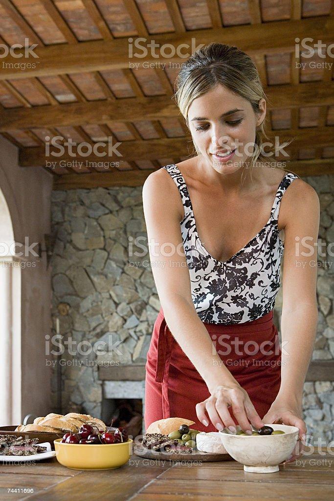 Woman preparing appetizers royalty-free stock photo