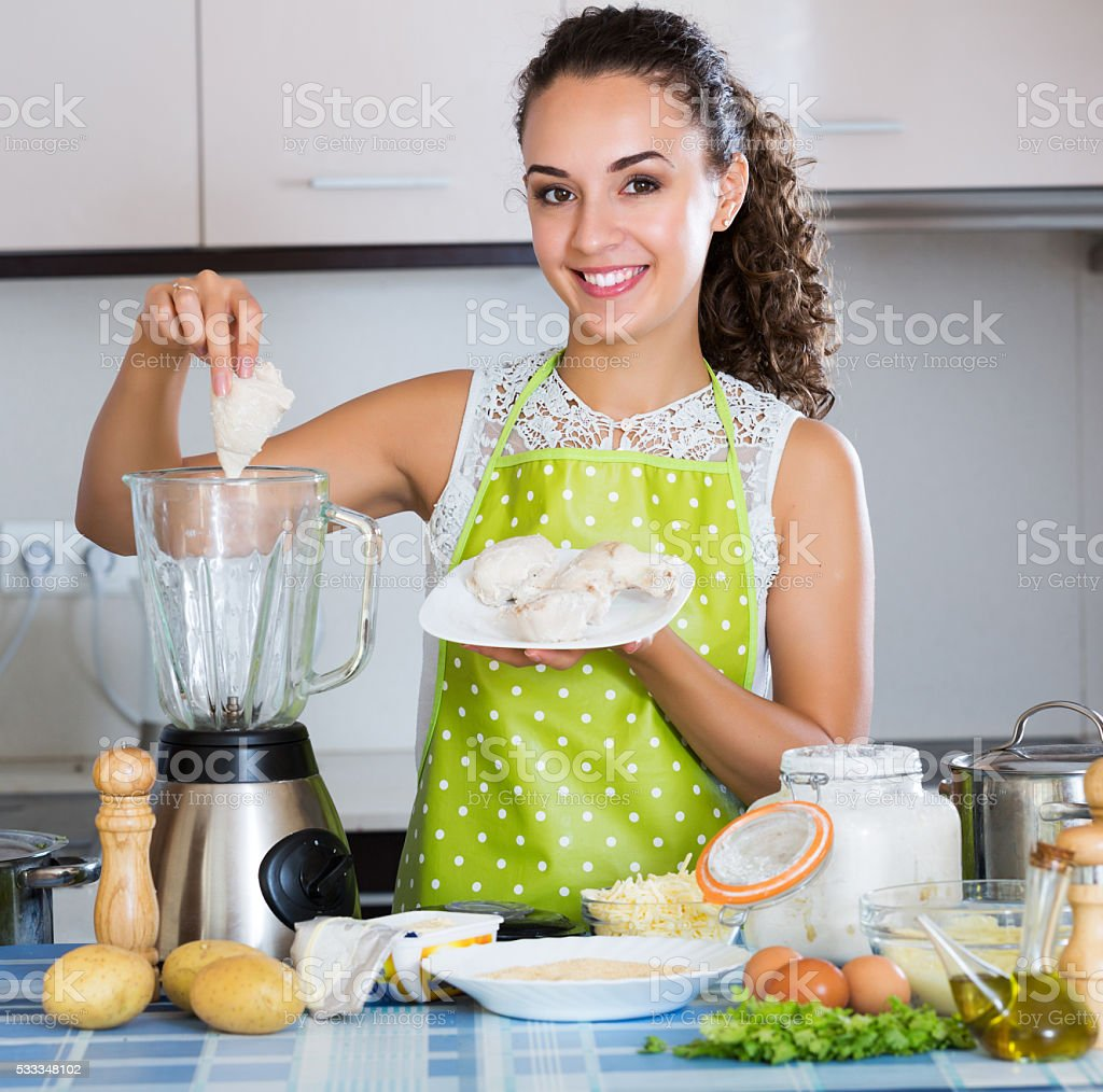 Woman preparing chicken pate stock photo