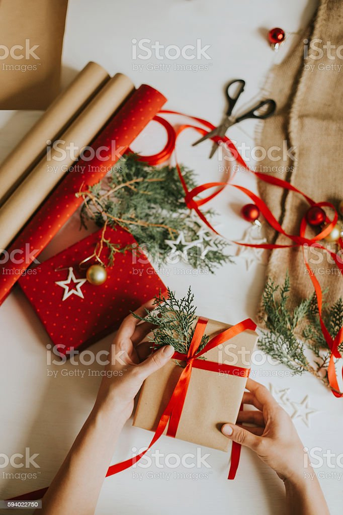 Woman preparing Christmas present stock photo