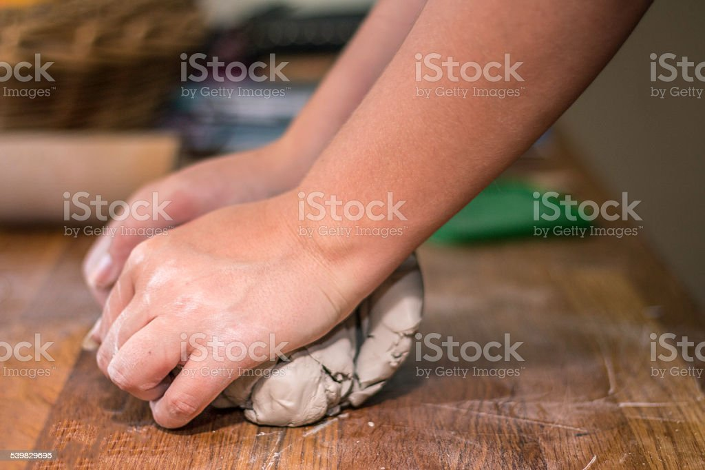 Woman preparing clay stock photo
