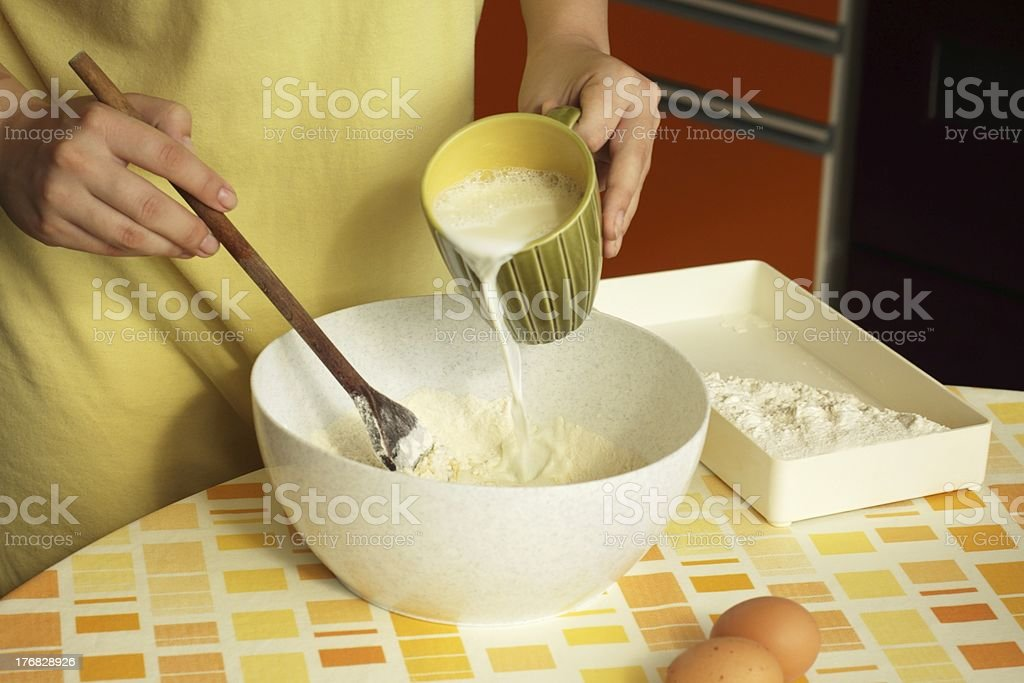 Woman preparing dough royalty-free stock photo