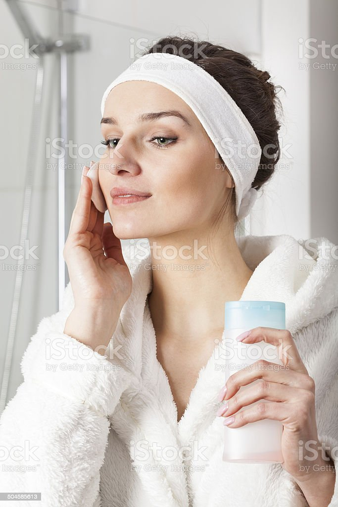 Woman preparing face for make up stock photo