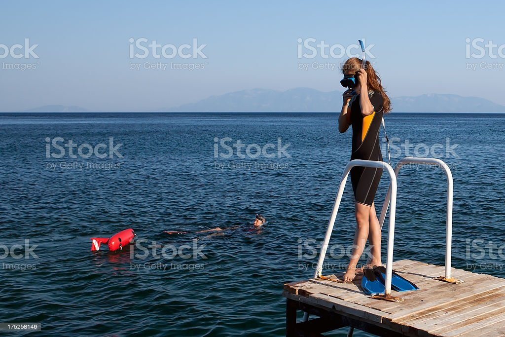 Woman Preparing for dive Man is waiting royalty-free stock photo