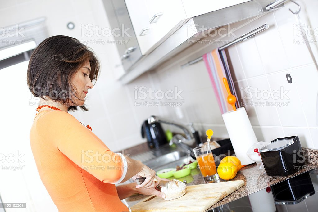 Woman preparing her healthy breakfast royalty-free stock photo