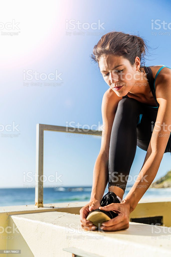 Woman preparing herself before exercise outdoors stock photo
