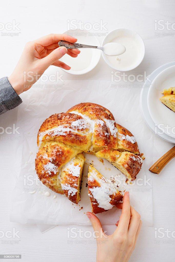 Woman preparing homemade tasty sweet bun stock photo