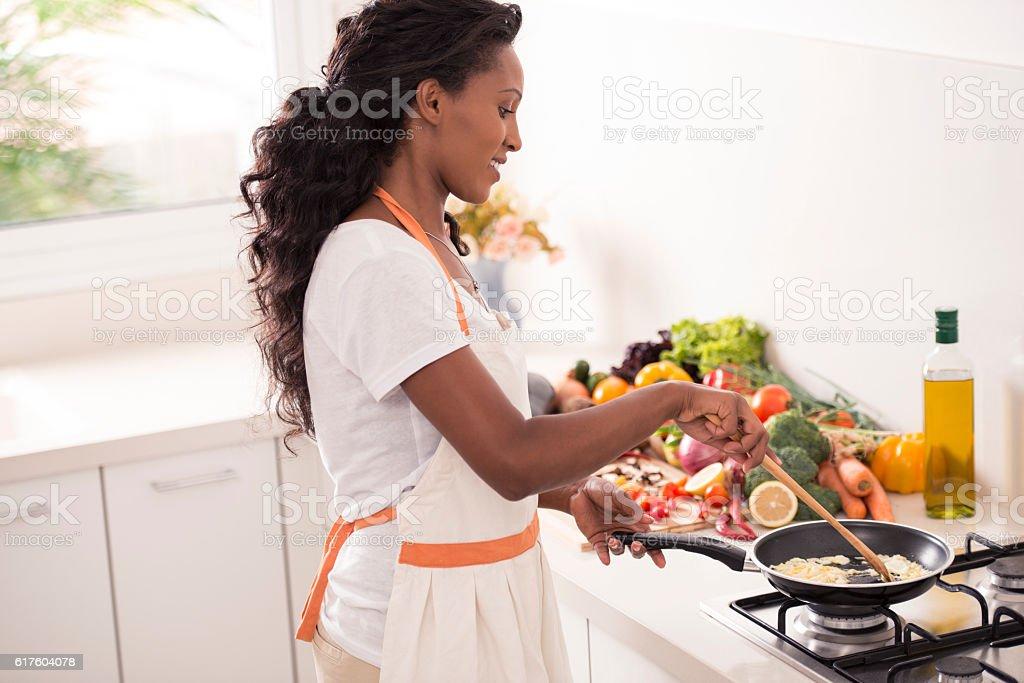 Woman preparing omelette. stock photo