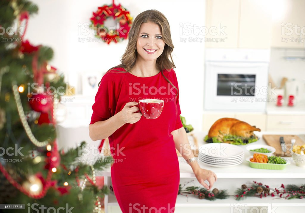 Woman preparing roasted turkey for christmas dinner. royalty-free stock photo