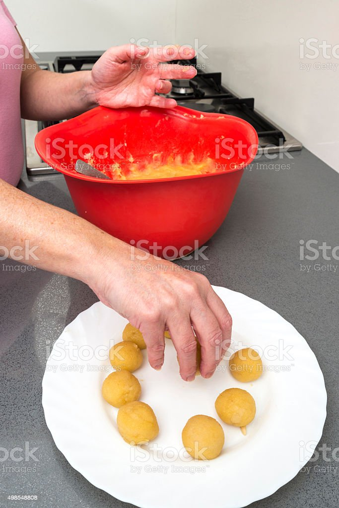 Woman preparing sweets in the kitchen stock photo