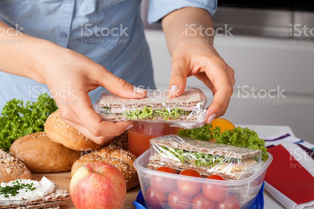 Woman preparing takeaway meal stock photo