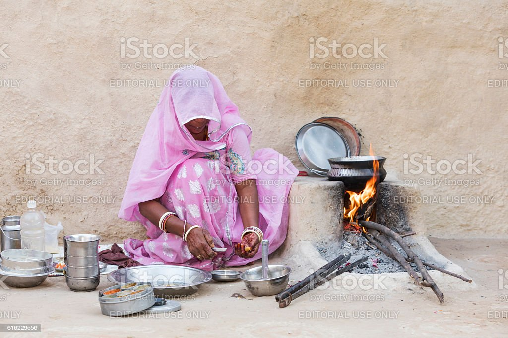 Woman preparing the pies chapati, Rajasthan, India stock photo