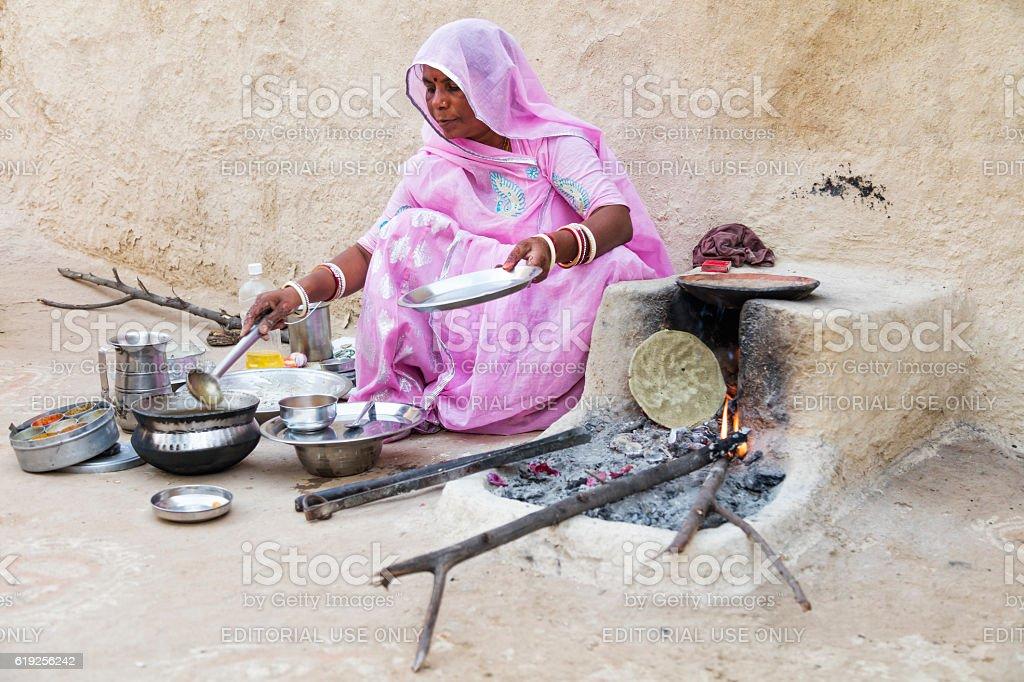 Woman preparing the pies chapati, Rajasthan, India stock photo