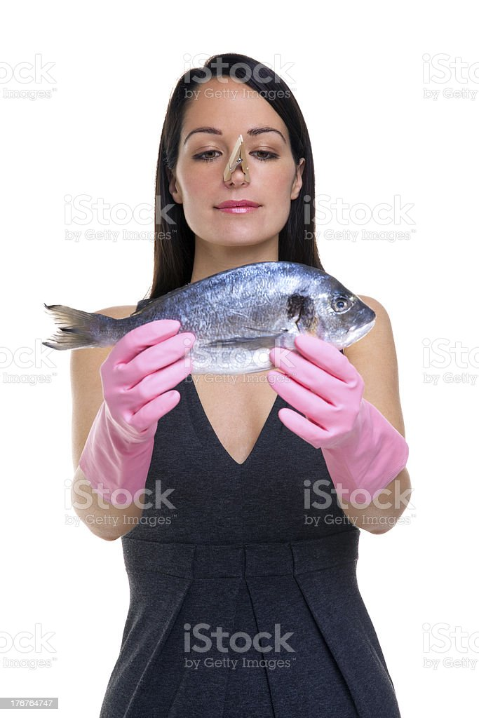 Woman preparing to cook fish royalty-free stock photo