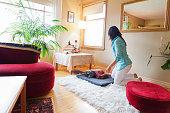 Woman preparing to meditate at home