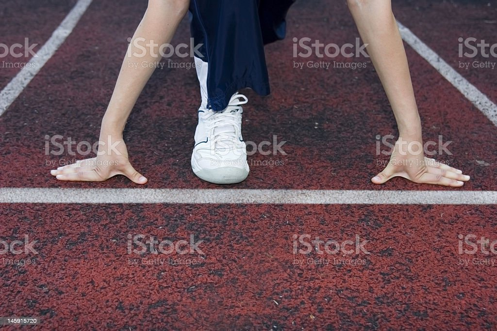 woman preparing to run on racetrack royalty-free stock photo