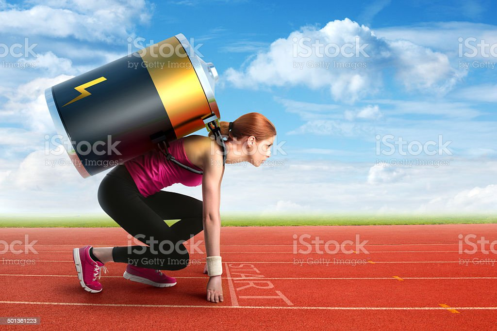Woman preparing to run with a battery on her back stock photo