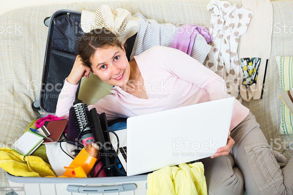 Woman preparing to travel stock photo