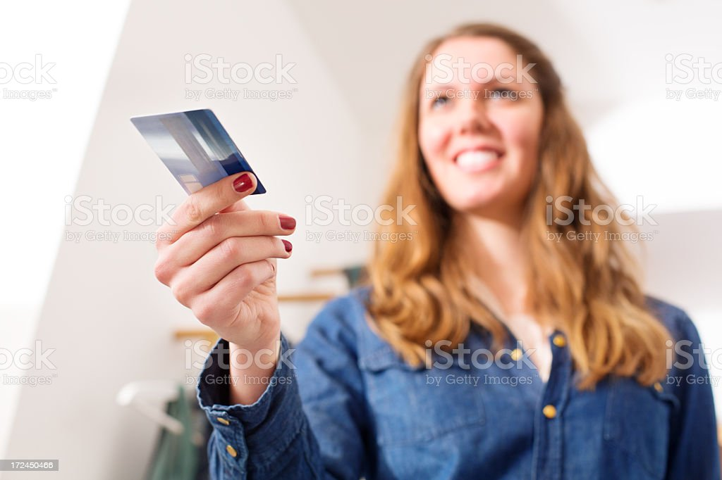 Woman presenting a credit card royalty-free stock photo