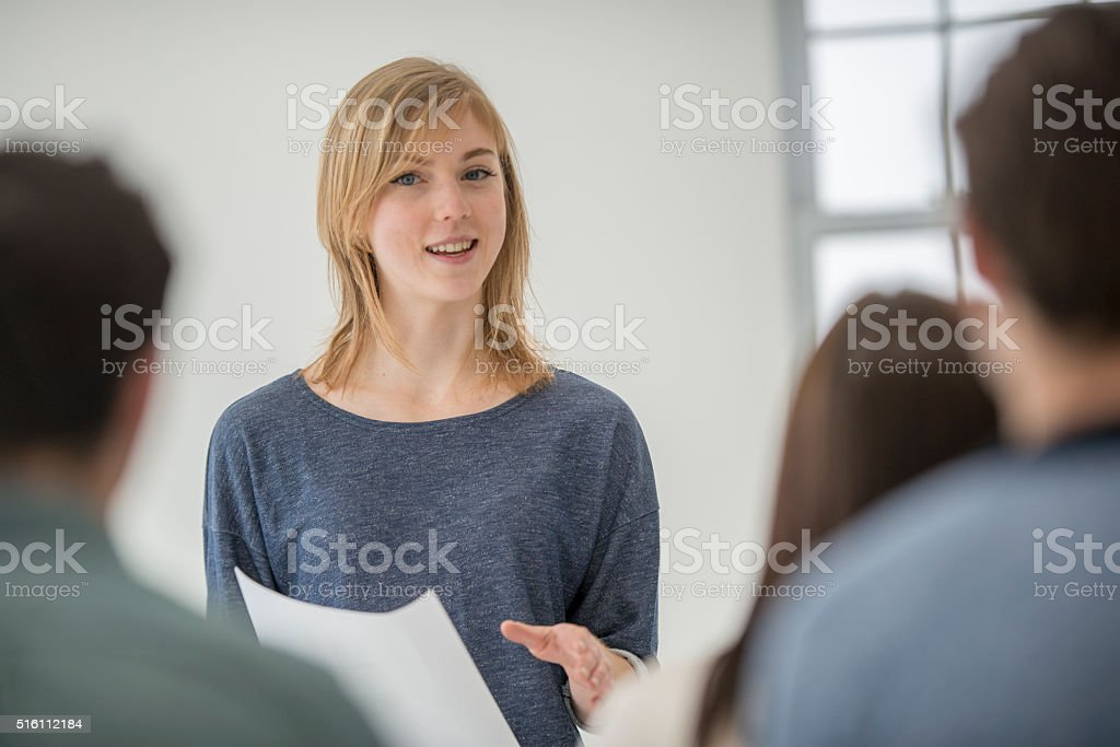 Woman Presenting in a University Class stock photo