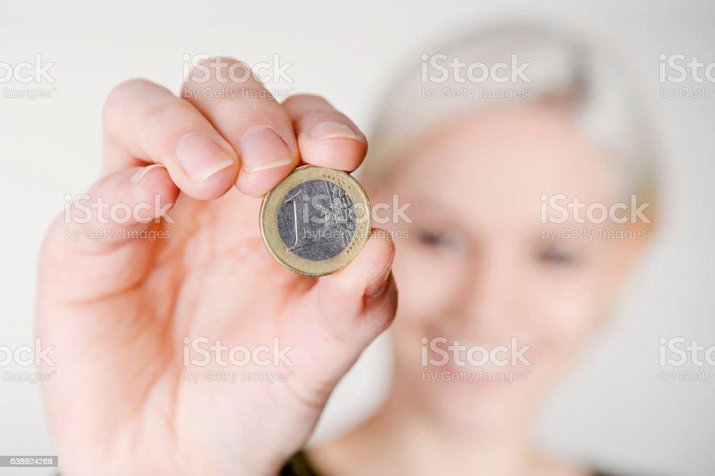 woman presenting one Euro stock photo