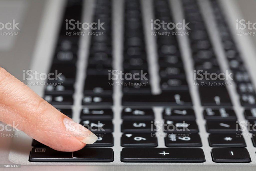 woman pressing enter key royalty-free stock photo