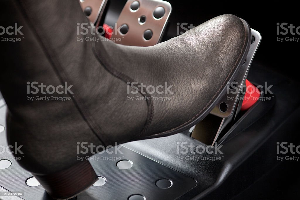 Woman pressing the gas pedal with her foot stock photo