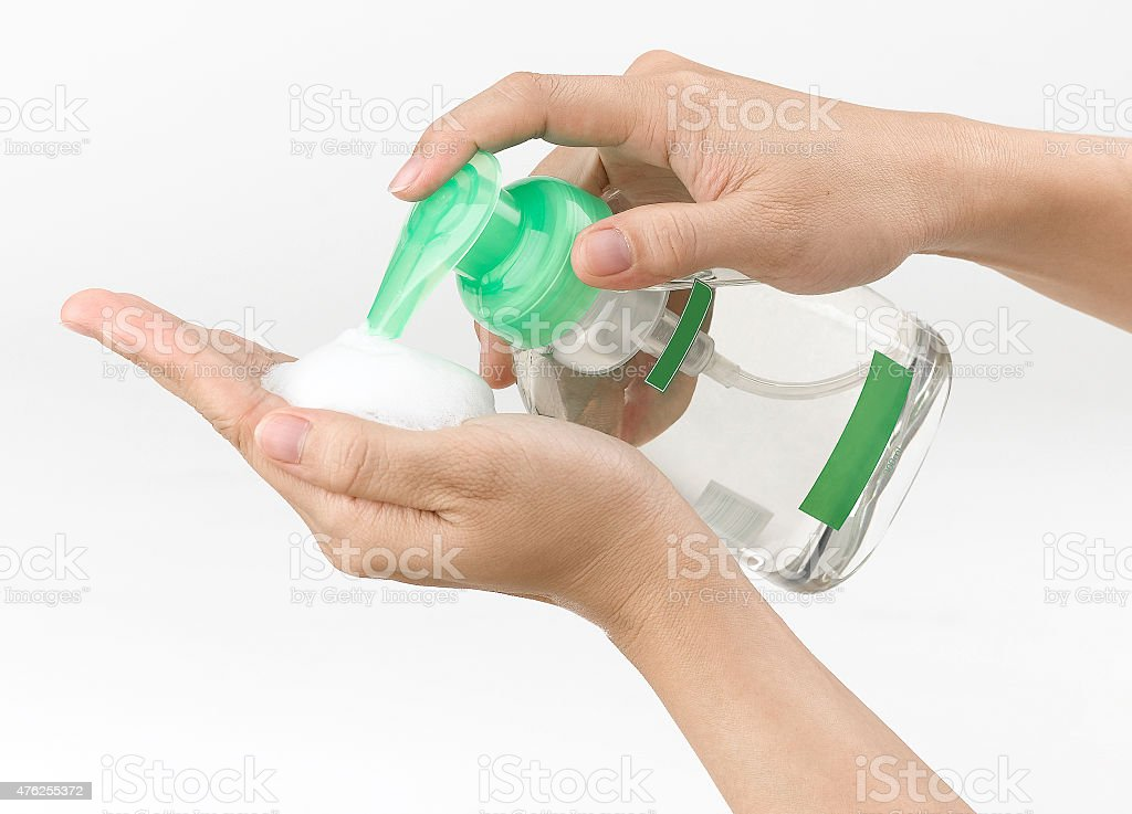 woman pressing the liquid soap stock photo
