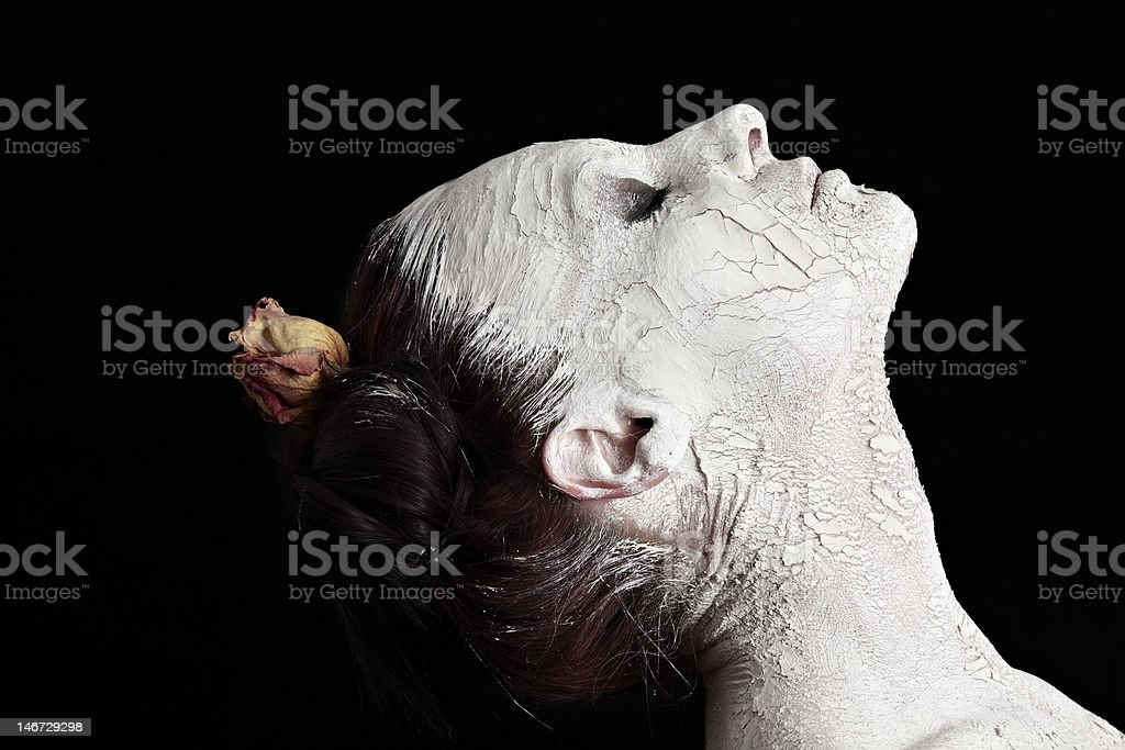 woman profile, chalk face mask, dry rose in hair royalty-free stock photo