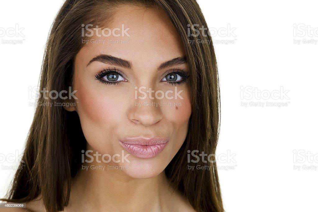 Woman puckering up stock photo