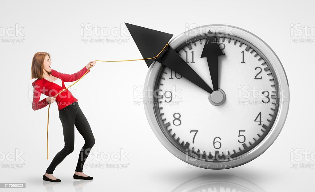 Woman pulling clock hands backwards stock photo