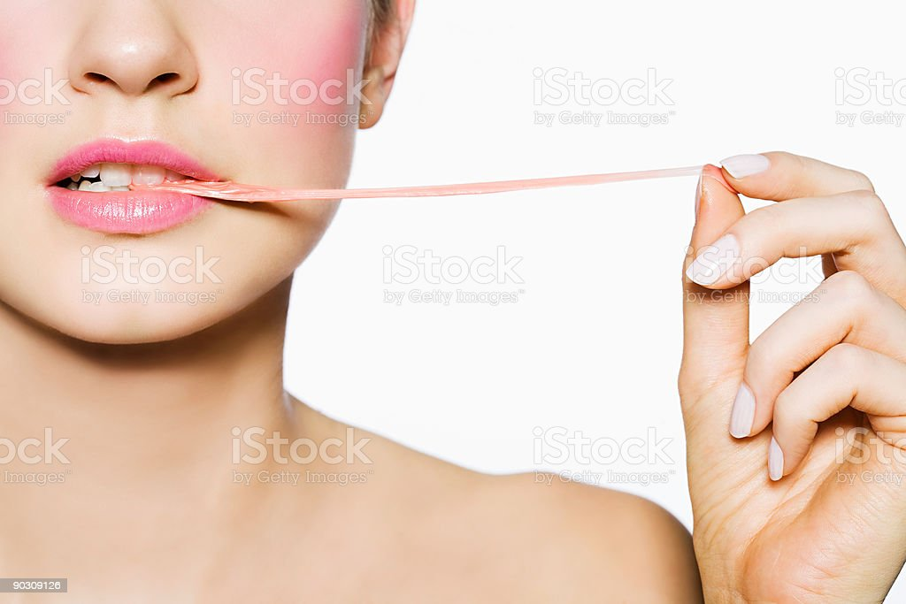 Woman pulling gum out of her mouth stock photo