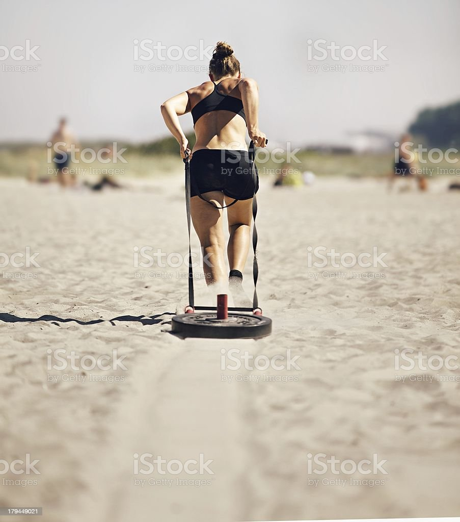Woman Pulling gym Sled stock photo