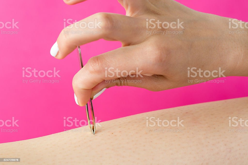 Woman pulling hair with a tweezers stock photo