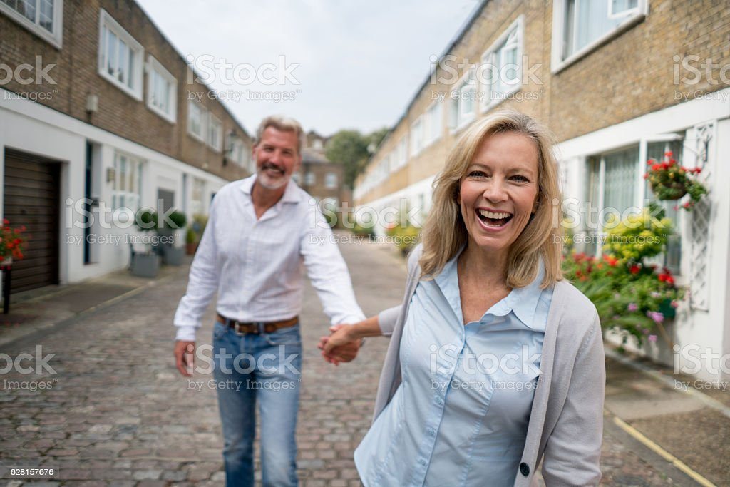 Woman pulling her couple on the street stock photo