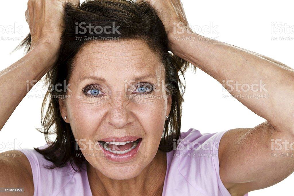 Woman pulling her hair out royalty-free stock photo