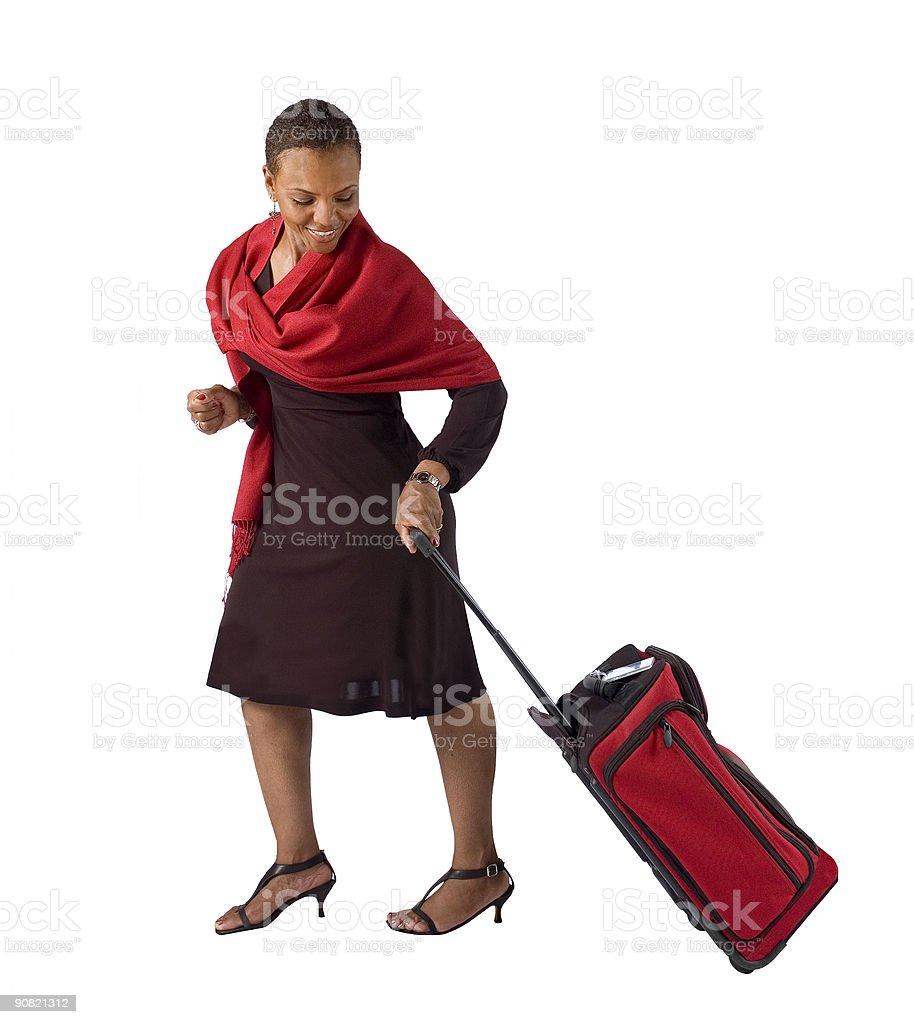 Donna tirando bagagli foto stock royalty-free