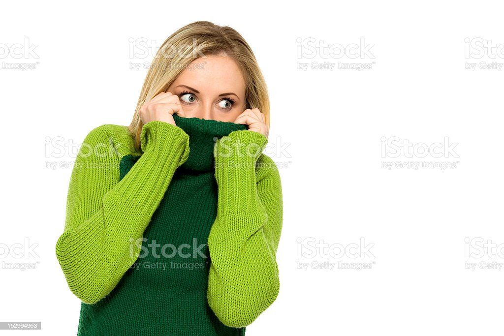 Woman pulling sweater over face royalty-free stock photo