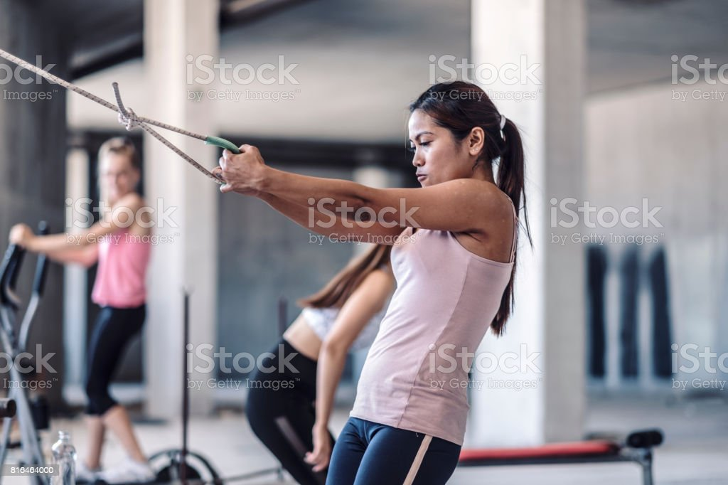Woman pulling weights in improvised ghetto fitness stock photo