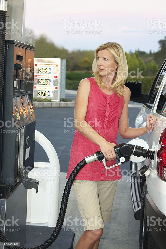 Woman Pumping Gasoline royalty-free stock photo