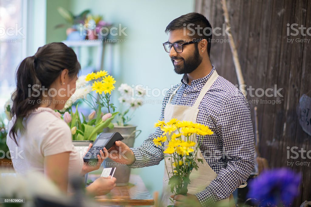 Woman Purchasing a Bouquet of Flowers stock photo